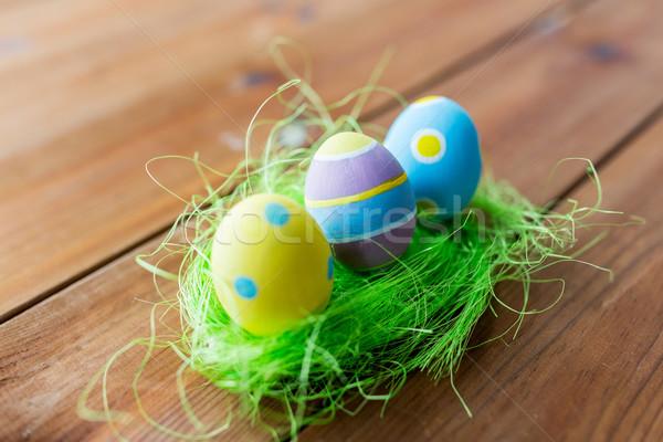 Közelkép színes húsvéti tojások fű húsvét ünnepek Stock fotó © dolgachov