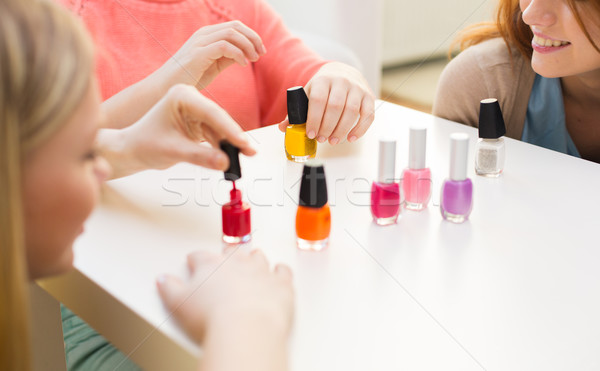 close up of smiling young women with nail polish Stock photo © dolgachov