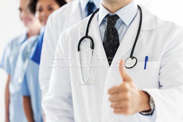 Glücklich Arzt Daumen Geste Stock foto © dolgachov