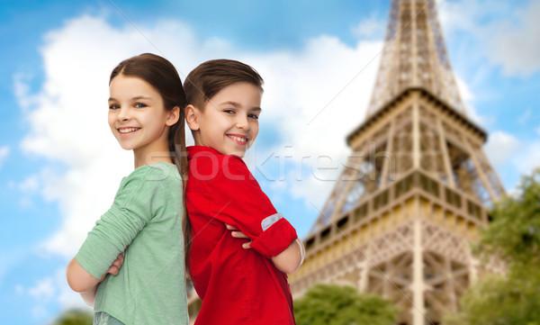 Kız ayakta Eyfel Kulesi çocukluk seyahat Stok fotoğraf © dolgachov
