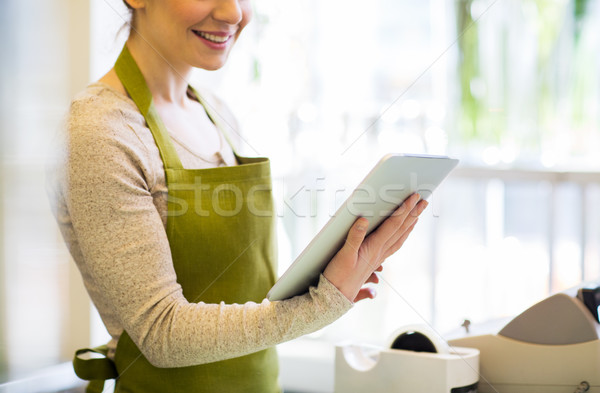 close up of woman with tablet pc at flower shop Stock photo © dolgachov