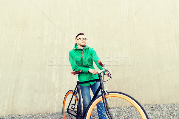 happy young hipster man with fixed gear bike Stock photo © dolgachov