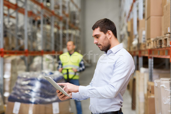 businessman with tablet pc at warehouse Stock photo © dolgachov