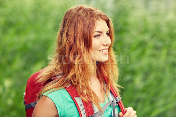 smiling young woman with backpack hiking in woods Stock photo © dolgachov