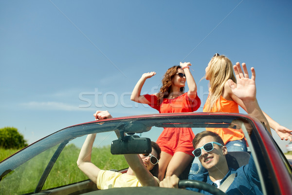 happy friends driving in cabriolet car Stock photo © dolgachov