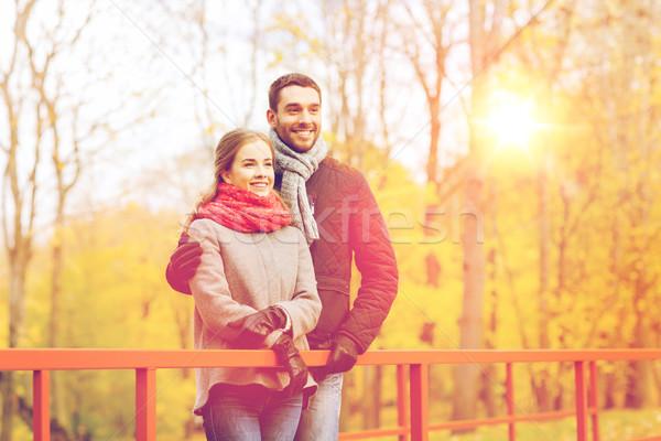 улыбаясь пару моста осень парка Сток-фото © dolgachov