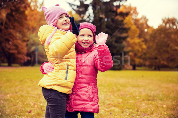 happy little girls waving hands in autumn park Stock photo © dolgachov