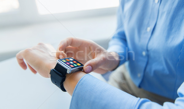 close up of hands with menu icons on smart watch Stock photo © dolgachov