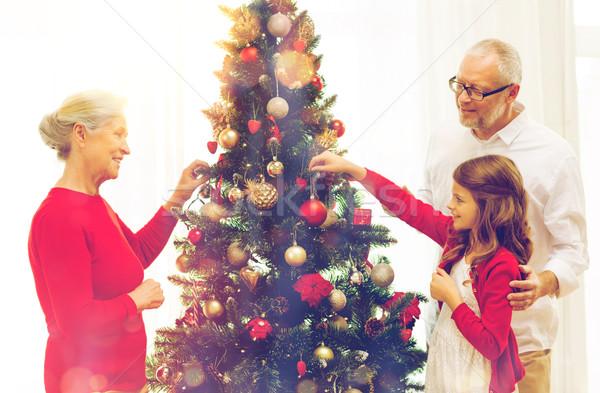 Mosolyog család karácsonyfa otthon ünnepek generáció Stock fotó © dolgachov
