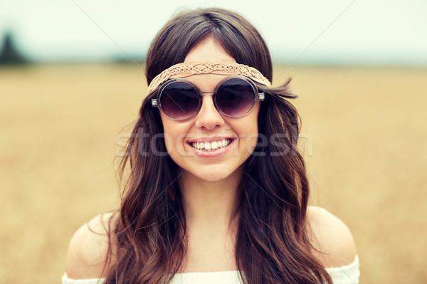 smiling young hippie woman in sunglasses outdoors Stock photo © dolgachov