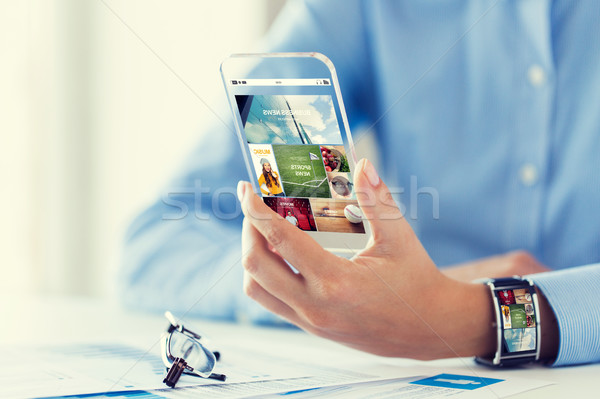 close up of woman with application on smartphone Stock photo © dolgachov
