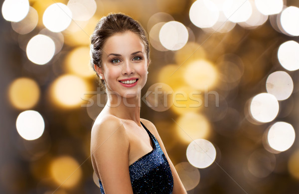 smiling woman in evening dress and pearl earring Stock photo © dolgachov