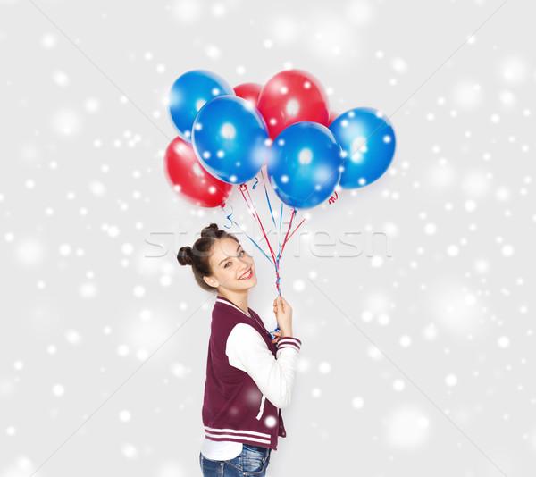 Gelukkig tienermeisje helium ballonnen sneeuw winter Stockfoto © dolgachov