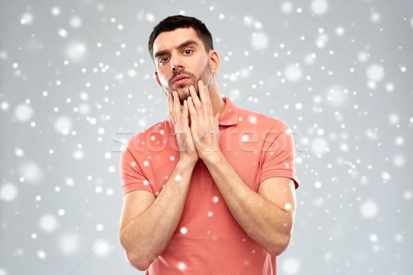 Fiatalember megérint arc hó arckifejezés tél Stock fotó © dolgachov