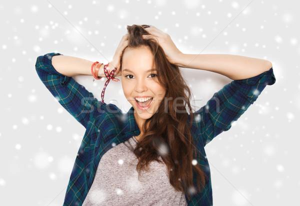 happy smiling pretty teenage girl over snow Stock photo © dolgachov