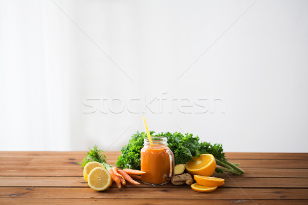 glass jug of carrot juice, fruits and vegetables Stock photo © dolgachov