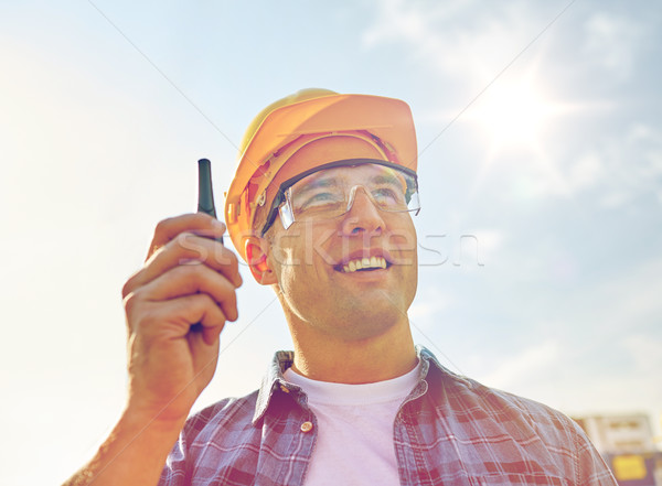 Stock photo: close up of builder in hardhat with walkie talkie
