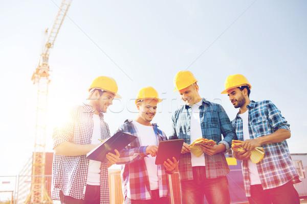 Grupo sonriendo constructores aire libre negocios Foto stock © dolgachov