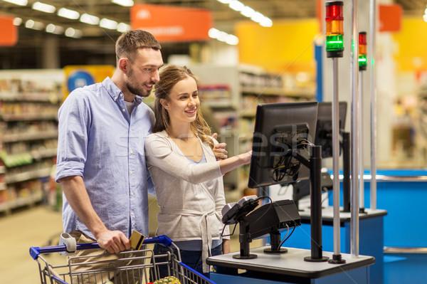Pár vásárol étel élelmiszer pénztárgép vásárlás Stock fotó © dolgachov