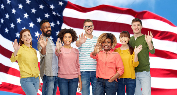 international people waving hand and american flag Stock photo © dolgachov