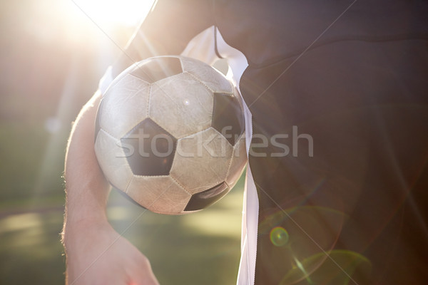 close up of soccer player with ball on field Stock photo © dolgachov