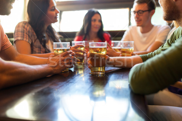 friends drinking beer at bar or pub Stock photo © dolgachov