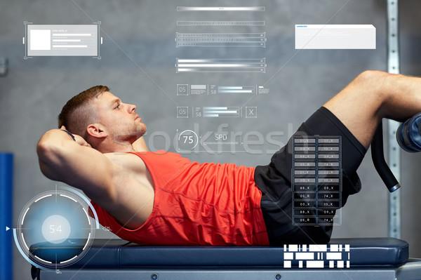 молодым человеком брюшной спортзал спорт фитнес Сток-фото © dolgachov