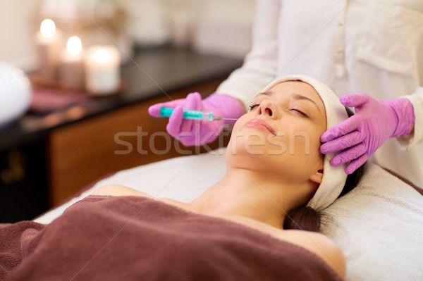 beautician doing beauty injection to woman lips Stock photo © dolgachov