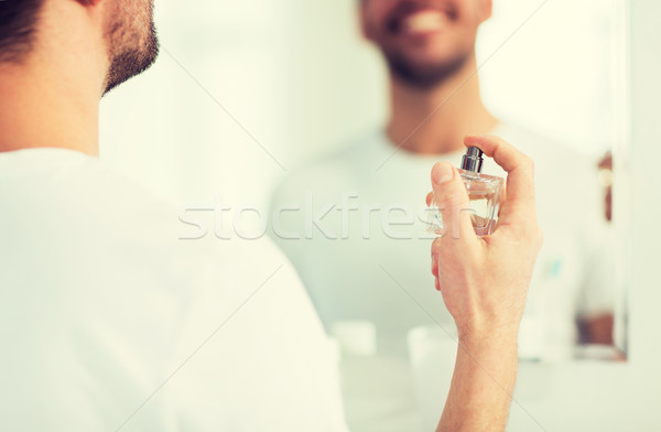 close up of man perfuming with perfume at bathroom Stock photo © dolgachov