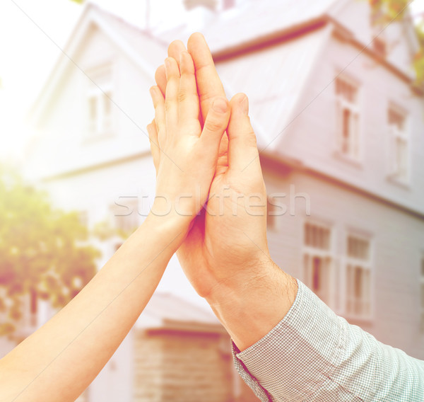 father and child hands making high five over house Stock photo © dolgachov