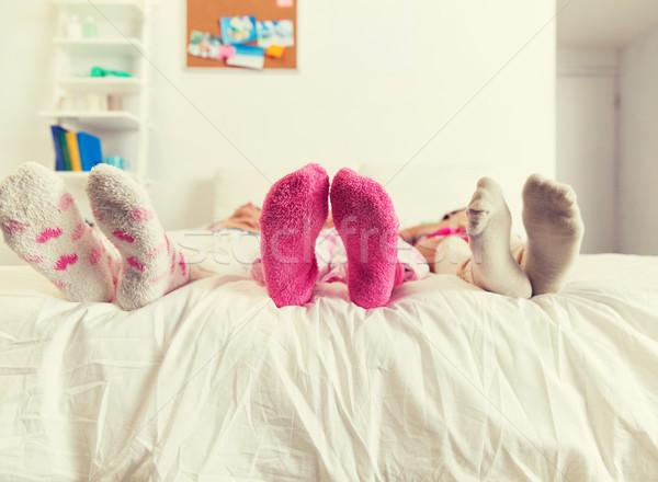 Kadın ayaklar çorap yatak ev Stok fotoğraf © dolgachov