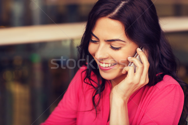 happy woman calling on smartphone at restaurant Stock photo © dolgachov
