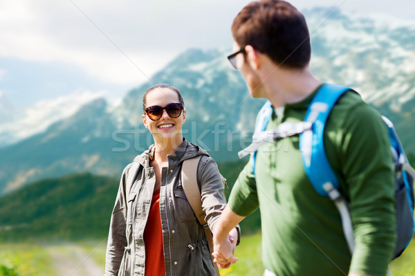 happy couple with backpacks traveling in highlands Stock photo © dolgachov