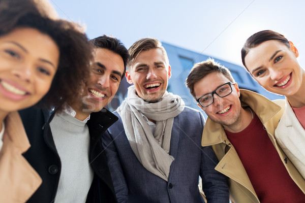 group of happy people or friends on city street Stock photo © dolgachov