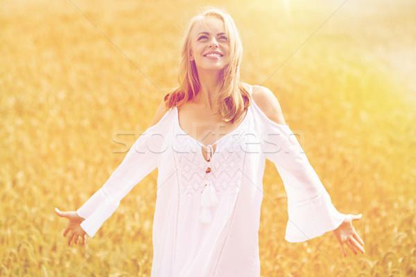 Uśmiechnięty młoda kobieta biała sukienka zbóż dziedzinie kraju Zdjęcia stock © dolgachov