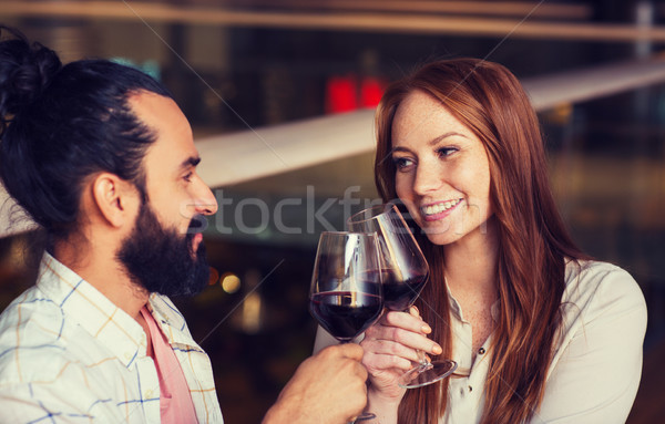 couple drinking red wine and clinking glasses Stock photo © dolgachov
