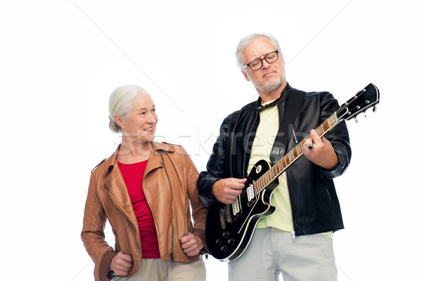 happy senior couple with electric guitar Stock photo © dolgachov