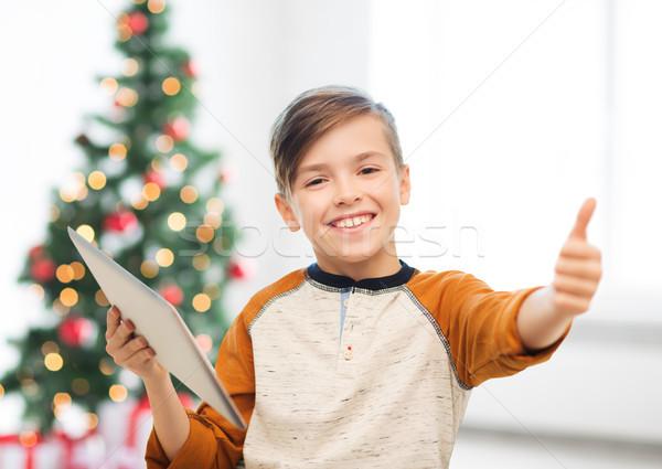 Jongen tonen christmas kinderen Stockfoto © dolgachov