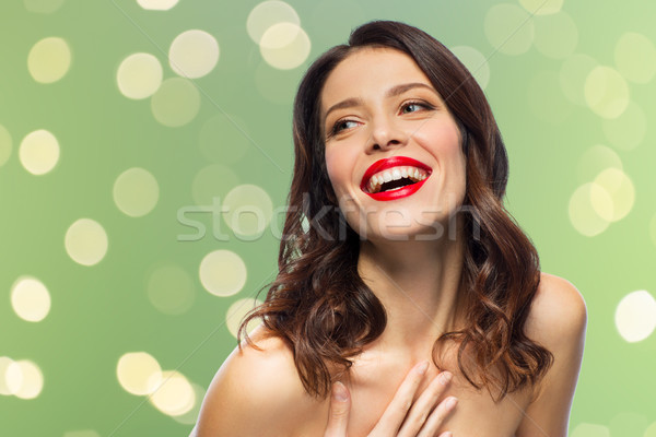 Güzel gülme genç kadın kırmızı ruj güzellik makyaj Stok fotoğraf © dolgachov