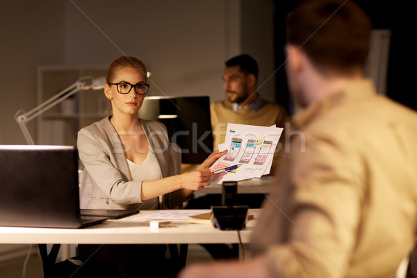 workers with user interface mockup at night office Stock photo © dolgachov