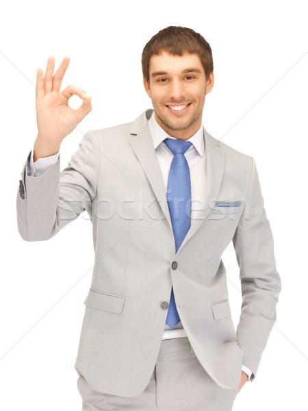 красивый мужчина вызывать знак ярко фотография Сток-фото © dolgachov