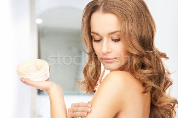 Gyönyörű nő hidratáló kép nő arc fürdőszoba Stock fotó © dolgachov