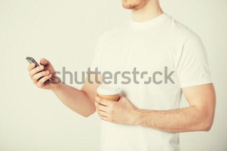 man hand with blank paper Stock photo © dolgachov