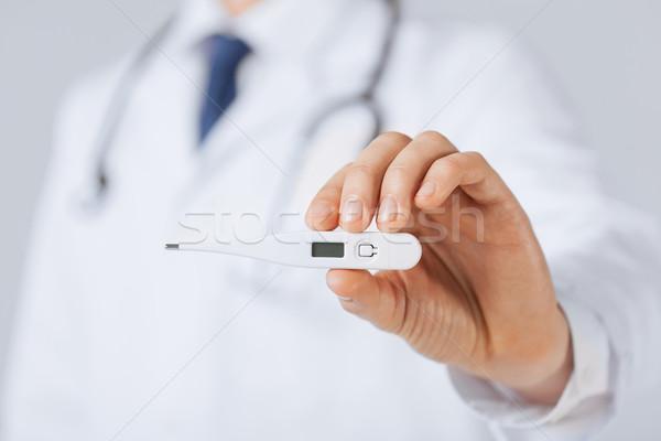 Erkek doktor termometre parlak doktor sağlık Stok fotoğraf © dolgachov