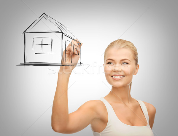 woman drawing house on virtual screen Stock photo © dolgachov