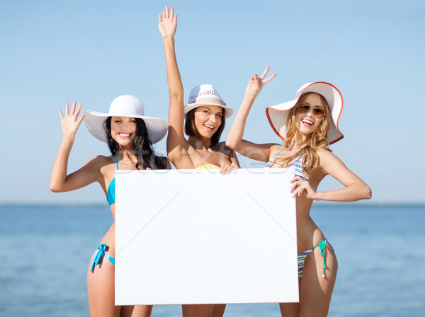 girls with blank board on the beach Stock photo © dolgachov