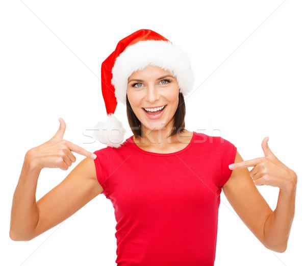 улыбающаяся женщина помощник Hat Рождества рождество Сток-фото © dolgachov