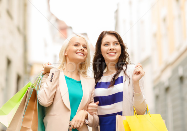 beautiful women with shopping bags in the ctiy Stock photo © dolgachov