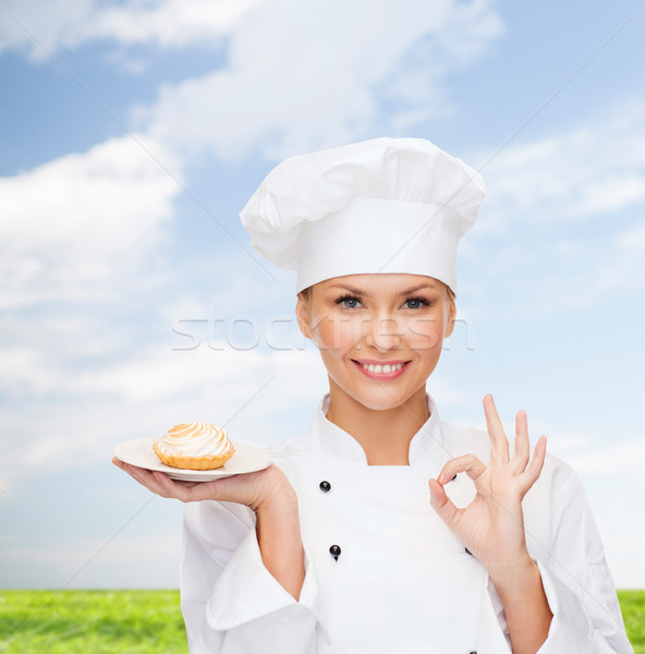 smiling female chef with cake on plate Stock photo © dolgachov