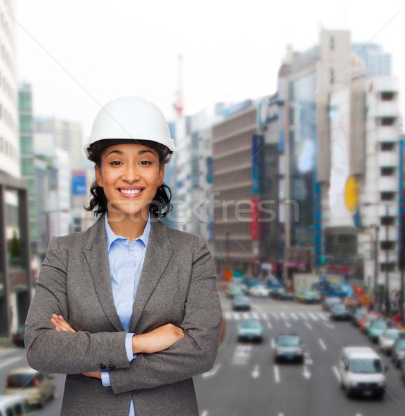 businesswoman in white helmet with crossed arms Stock photo © dolgachov